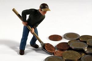 geld-muenzen-schaufel